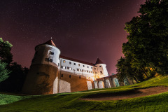 Mokrice castle at night with a starry night above. Dark and peaceful atmosphere under milky way.
